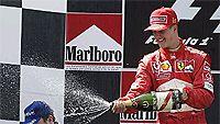 Schumi suihkuttaa, Alonsolla samppanjaa silmissä, Photo: Clive Mason