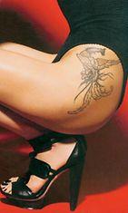Maggie Q:n tatuoinnissa komeilee feeniks-lintu.