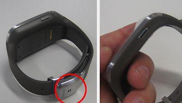 Kaiutin sijaitsee punaisen ympyrän kohdalla. Kellon kyljessä on painike, jonka avulla näyttö aktivoidaan. Kellon takana näkyy myös viisi pyöreää liitintä lataustelakkaa varten.