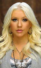 2012: Christina Aguilera esiintyy nälänhädän vastaisessa kampanjassa.