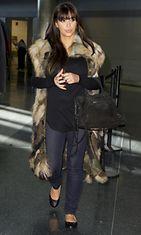 27.3.2013: Kim Kardashian lentomatkan jälkeen.