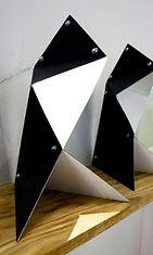 HAI- pöytävalaisin yhteistyössä Outokone Designin kanssa (jämäteräspaloista taiteltuja)