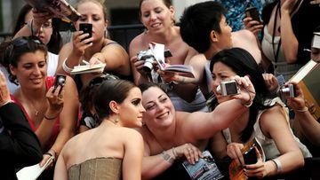 Actress Emma Watson (L), of England, poses with fans while arriving for the North American premier of 'Harry Potter and the Deathly Hallows Part 2' at Lincoln Center in New York, New York, USA, on 11 July 2011.