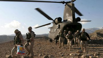 A file photograph dated 24 December 2004 shows US soldiers disembark a US CH-47 Chinook helicopter in Sarobi district to celebrate Christmas with Afghanis.