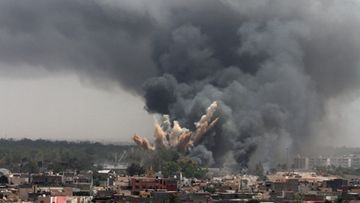 A file picture dated 07 June 2011 shows smoke rising in the sky after a NATO air strike in Tripoli, Libya.
