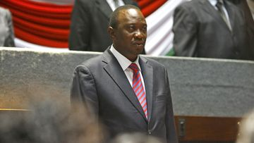 Kenya's President-elect Uhuru Kenyatta stands for a national anthem prior to a meeting with women leaders of his Jubilee coaliton in Nairobi, Kenya, 14 March 2013. Duing a meeting, Kenyatta said the country has no time to waste as Kenyans have to move on, referring to a move by his main rival and a defeated candidate Raila Odinga to challenge the election result in court.