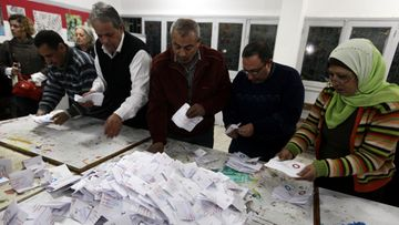 Egyptian election officials count ballots after voting in the second round of a referendum for the new Egyptian constitution, at a polling station in Giza, Egypt, 22 December 2012. More than 25 million eligible Egyptians were called to cast their ballots 22 December in the final phase of a referendum on a disputed draft constitution that has sparked demonstrations by pro- and anti-government protesters. Voting was taking place in 17 electoral districts that are considered to be broadly conservative, meaning a yes vote is expected to prevail.