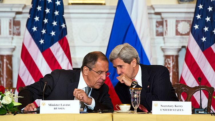 Russian Foreign Minister Sergei Lavrov (L) talks to US Secretary of State John Kerry (R) at the start of a meeting that also included Russian Defense Minister Sergei Shoygu and US Secretary of Defense Chuck Hagel, at the State Department in Washington DC, USA, 09 August 2013.