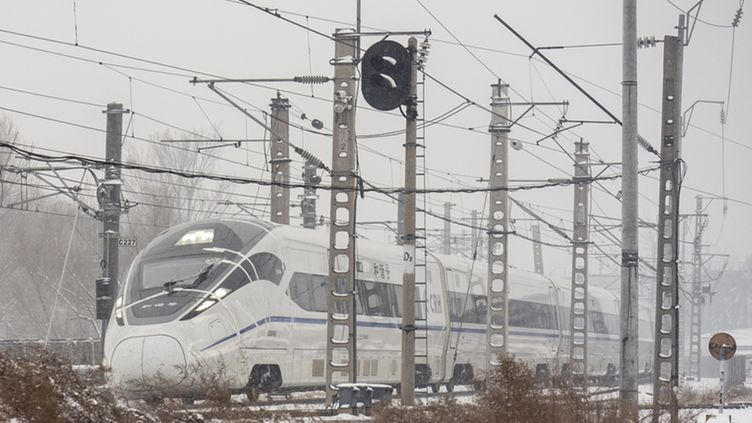 A high speed train undergoes testing in snowy conditions, covered with sensors taped to its front, at the national railway technology center in the suburbs of Beijing, China, 14 December 2012. Beijing has had three days with snow coming just one week after what local media reported as the coldest week in 14 years.