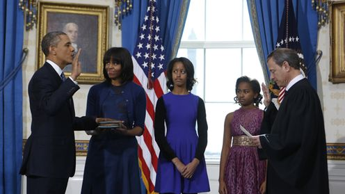 US President Barack Obama (L) takes the oath of office from US Supreme Court Chief Justice John Roberts (R) as first lady Michelle Obama (2-L) holds the bible and their daughters Malia (C) and Sasha look on in the Blue Room of the White House in Washington DC, USA, 20 January 2013. EPA/LARRY DOWNING / POOL