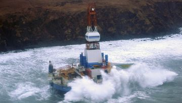 An undated handout picture released by the US Coast Guard on 01 January 2013 shows the Shell mobile offshore drill rig 'Kulluk' as it is pounded by waves whilst sitting aground near Sitkalidak Island, Alaska, USA. The oil rig was towed to Seattle for maintenance on 28 December 2012 when it's tugboat experienced multiple engine failure and it ran aground. According to press reports the rig has large amounts of diesel fuel and 'other petroleum' products on board but there are no signs of breach of the hull as yet. EPA