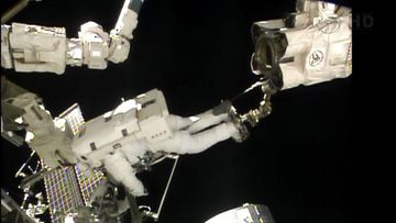 A frame grab from NASA TV shows Italian Air Force pilot and European Space Agency astronaut Luca Parmitano (Top) and NASA astronaut Chris Cassidy of the US (Bottom) during a space walk outside the International Space Station on 09 July 2013. The astronauts were scheduled to spend more than six hours preparing the space station for the installation of a Russian module and other tasks. Parmitano is the first Italian astronaut to walk in space according to NASA.