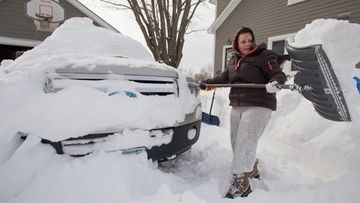 Hefty task....Katelynn Lebeau clears snow from her driveway in Hatfield, Massachusetts, USA 09 February 2013.