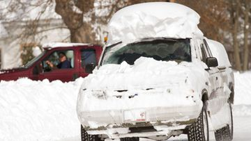 A partially snow covered truck drives down Main Street in Deerfield, Massachusetts, USA 09 February 2013. A massive winter storm dumped two feet of snow on the area and throughout the northeast US with possibly more to come today. EPA/MATTHEW CAVANAUGH