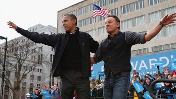 MADISON, WI - NOVEMBER 05: Rocker Bruce Springsteen (L) welcomes U.S. President Barack Obama to the stage during a rally on the last day of campaigning in the general election November 5, 2012 in Madison, Wisconsin. Obama and his opponent, Republican presidential nominee and former Massachusetts Gov. Mitt Romney are stumping from one 'swing state' to the next in a last-minute rush to persuade undecided voters.