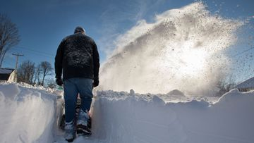 After the storm passed, Tyler Bowden clears the sidewalk with a snowblower in Greenfield, Massachusetts, USA, 09 February 2013. A massive winter storm dumped two feet of snow on the area and throughout the northeast US with possibly more to come today. EPA/MATTHEW CAVANAUGH