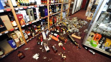 Broken bottles litter the floor of a wine and spirits store following a magnitude 6.5 earthquake, in Wellington, New Zealand, July 21, 2013. The quake, which hit about 5.10pm local time was centred 20km east of Seddon in the Cook Strait at a depth of 17km.