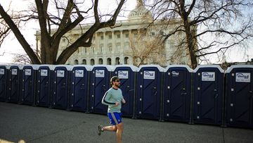 A early morning jogger runs past the portable restrooms surrounding the United States Capitol in Washington, DC, USA, 20 January 2013. The public ceremony for the swearing in of US President Barack Obama for his second term in office will take place on the West Front of the Capitol Building on 21 January. EPA/PETE MAROVICH