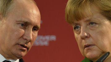 Merkel soitti Putinille – vaati selityst� ven�l�isjoukoista