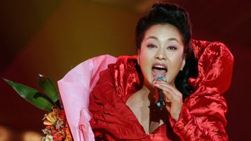 A picture made available on 01 November 2010 shows Chinese performer Peng Liyuan, wife of Chinese Vice President Xi Jinping, singing a folk song onstage in Luoyang, in central China's Henan province, 10 April 2007. Peng, a professional singer, holds the military rank as a major general. On 18 October 2010, Vice President Xi Jinping was promoted to vice chairman of China's Central Military Commission, a key post considered to solidify his status as the country's leader-in-waiting ahead of a Communist Party congress scheduled for 2012.