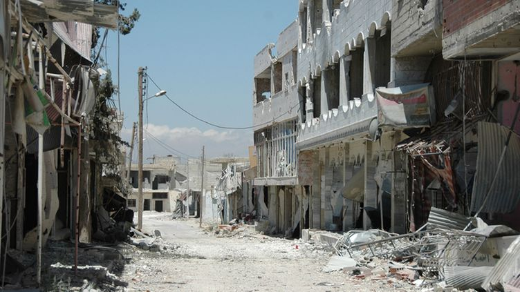 A general view shows damaged buildings in Qusair city, Homs province in central Syria, 05 June 2013, after the Syrian soldiers seized total control of the city and the surrounding regions. The Syrian army, backed by Hezbollah regained control of the strategic town of Qusair following weeks of heavy fighting, state media and the opposition reported. The town, near the Lebanese border, has been the scene of fierce fighting for more than two weeks. Activists say fighters from al-Assad's allies across the border and rebel groups from northern and eastern Syria were drawn into the battle.