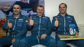 Expedition 34 Russian Flight Engineer Evgeny Tarelkin, Russian Soyuz Commander Oleg Novitskiy and Flight Commander Kevin Ford of NASA sitting together at the Kustanay Airport a few hours after they landed near the town of Arkalyk, Kazakhstan, 16 March 2013