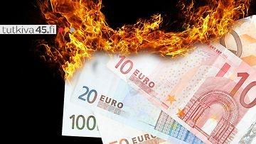 Euro-seteleitä tulessa, kuvituskuva.