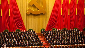 Delegates rise during the national anthem at the opening ceremony of the 18th CPC (Communist Party Congress) at the Great Hall of the People in Beijing, China 08 November 2012. The CPC is expected to introduce the new leadership lineup and the Standing Committee of the Politburo.