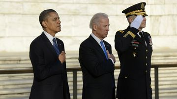 US President Barack Obama (L), Vice President Joe Biden (C) and Major General Michael S. Linnington (R), Commander of the US Army Military District of Washington, participate in a wreath-laying ceremony at the Tomb of the Unknown Soldier in Arlington National Cemetery, Arlington, Virginia, USA, 20 January 2013. EPA/MICHAEL REYNOLDS