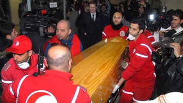 A handout photograph released by the Syrian Arab News Agency (SANA), staffers of the Red Crescent carrying the coffin of US journalist Marie Colvin, during the handover of her body along with the body of French journalist Remi Ochlik, at al-Assad University Hospital in Damascus, Syria, 03 March 2012. The Syrian government claimed that it found the bodies of the two journalists, who were killed in a rocket attack on a make-shift press centre, at the flashpoint neighborhood of Baba Amr in central Syria on 01 March. The bodies were transferred overnight to the Hospital in Damascus for DNA test before handing them over to the French and Polish ambassadors in Syria.