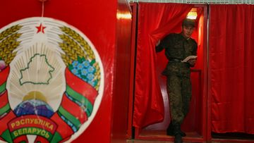 A Belarussian soldier leaves a voting booth with his ballot paper at a polling station during the parliamentary elections in Minsk, Belarus, 23 September 2012. Voters in the former Soviet republic of Belarus began electing a new parliament. EPA/TATYANA ZENKOVICH