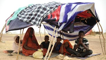 A picture made available on 19 July 2012 shows a family from Mali sits under a tent on the terrain of a refugees camp near Dori, Burkina Faso, on 04 July 2012. According to reports, over 370,000 people have been displaced by the violence in Mali and continue to cross the borders into the hunger-stricken Burkina Faso and Niger. EPA/HELMUT FOHRINGER