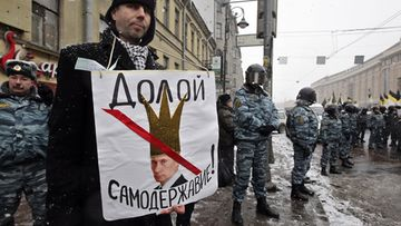 A man holds a poster depicting Russian Prime Minister Vladimir Putin wearing a crown, reading 'Down with autocracy' during an opposition rally in St.Petersburg, Russia, 26 February 2012. Several thousands people took part in a march demanding fair elections and protesting against Russian Prime Minister Vladimir Putin's rule. Putin runs for a third presidential term at the upcoming president elections scheduled on 04 March 2012. EPA/ANATOLY MALTSEV  26.2.2012 Epa.