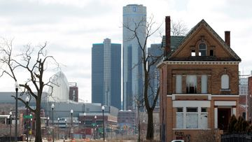 March 2013 an empty house with the GM Building in downtown Detroit in the background is seen in Detroit, Michigan, USA. The city of Detroit filed for Chapter 9 bankruptcy protection according to an official 18 July 2013.