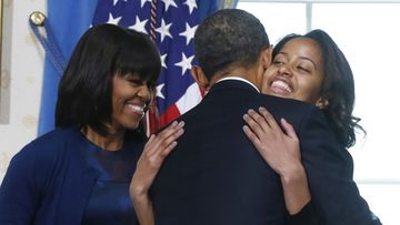 U.S President Barack Obama gets a hug from his daughter Malia as wife Michelle (L) and Sasha looks on in the Blue Room of the White House in Washington, January 20, 2013 after he took the oath of office. EPA/LARRY DOWNING