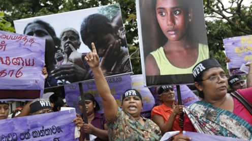 "A socialist woman activist shouts slogans during a protest against the rising cost of living and violence against women in Colombo, Sri Lanka, Thursday, March 8, 2012, marking International Women's day. A wave of protests erupted across the island nation during the last weeks after the government increased fuel prices, citing rising world oil prices. Placard on left bottom reads ""pay social insurance for women affected by war."" (AP Photo/Gemunu Amarasinghe"