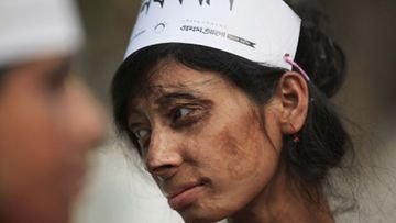 Monira, a survivor of an acid attack, takes part in an awareness rally about the violence against women as they commemorate International Women's Day in Dhaka March 8, 2012. LEHTIKUVA / REUTERS/Andrew Biraj (BANGLADESH