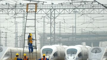 A picture made available on 17 June 2011 shows workers labor outside the maintenance center for CRH trains of the Beijing-Shanghai High-Speed Railway in Shanghai, China, on 16 June 2011.