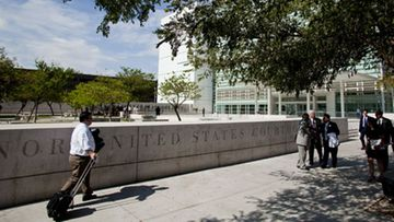Individuals  walk past the US district Courthouse in Phoenix, on 28 July 2010, where Judge Susan Bolton may make a ruling on Arizona's controversial  Senate Bill 1070 aimed at illegal immigration  in Arizona. A federal court on Wednesday blocked the key provision of Arizonas controversial  immigration  law that would have required police to check the immigration  status of suspects saying that it was neither equitable or in the public interest. The ruling came just a day before the law was due to go into effect. It had been challenged in the courts by a coalition of civil rights groups and by the federal government,  which argued that the law impinges on federal legislative  authority.