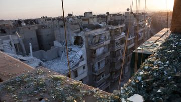Photo made available on 15 October shows partially destroyed buildings due to Syrian Army artillery shelling and bombing in Aleppo, Syria, 13 October 2012.