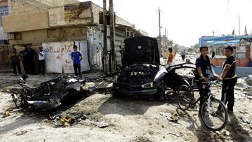 Iraqis inspect the site of a bomb attack in Husainiya town, north east of Baghdad, Iraq, 25 June 2013. Media reports state that at least 39 people were killed and 80 wounded in a series of bombings in several areas of Baghdad late 24 June 2013. EPA/AHMED ALI