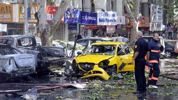 Turkish firemen and police officers search the area after a blast in Ankara, Turkey on 20 September 2011.