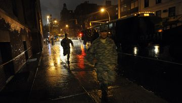 New York National Guard officers run towards the Sixty-Ninth Regiment Armory where they are staying ahead of Hurricane Irene in New York, New York, USA, 27 August 2011. The New York area is bracing for Hurricane Irene to hit late on August 27 and into August 28.