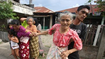 Residents of Banda Aceh evacuate following a tsunami warning in Aceh, Indonesia, 11 April 2012.