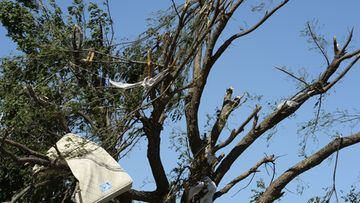 A bed matress hangs in a tree near a house in El Reno, Oklahoma, USA, 01 June 2013. At least nine people died in the central US state of Oklahoma after tornadoes struck an area already devastated by twisters less than two weeks ago, media reported on 01 June.