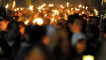 People take part in a torchlight procession for earthquake victims in L'Aquila, Italy, 05 April 2010 on the eve of the first anniversary of the devastating earthquake that hit the region on 06 April 2009.