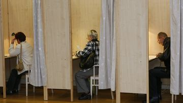 Latvians casts their ballot during early parliamentary elections in Amata, Latvia, 17 September 2011.