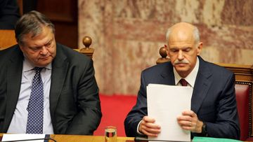 Greek Prime Minister George Papandreou (R) and Vice-President and Finance Minister Evangelos Venizelos (L), during the third day of the confidence vote debate in Athens, Greece, 04 November 2011.
