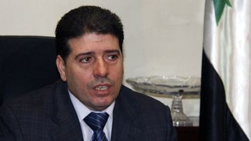 A photo made available on 09 August 2012 showing the then Syrian Health Minister, Wael Nader al-Halqi, during an event in Damascus, Syria, 19 August 2011. Media reports on 09 August 2012 state that Syrian President Bashar al-Assad had appointed al-Halqi as the new Prime Minister, replacing Riyad Hijab, who defected and fled the country. Halqi, 48, is a gynecologist, who previously held the post of the secretary general of the Daraa branch of the Baath party from 2000 to 2004. He was appointed as a head of the doctors' syndicate in 2010