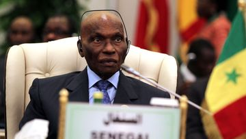 Senagal President Abdoulaye Wade looks on during a session of the Africa/EU summit in Tripoli, Libya, 29 November 2010. The Africa/EU Summit is due to take place in Libya on 29 and 30 November under the theme of Investment, Economic Growth and Job Creation . Heads of States and Governments are to address key issues, as peace and security, climate change, regional integration and private sector development, infrastructure and energy, agriculture and food security, migration.